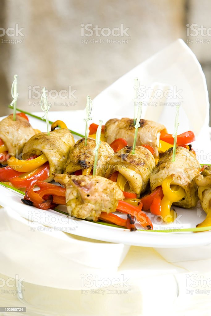 Roll meat with yellow and red peppers, sauce, vegetables royalty-free stock photo