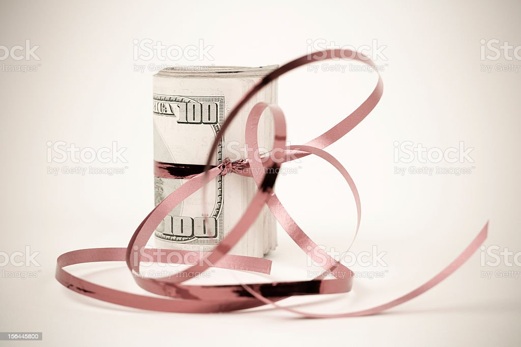 Roll of $100 Bills with a Ribbon royalty-free stock photo