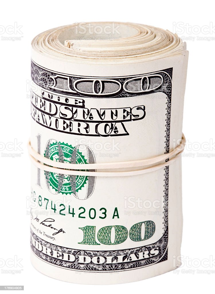 A roll of 100 dollar bills wrapped in a rubber band stock photo