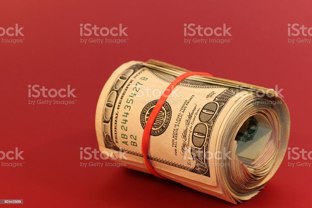 Roll of $100s stock photo