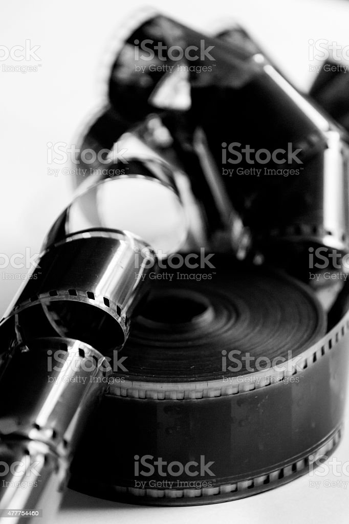 Roll of 35mm film in black and white stock photo