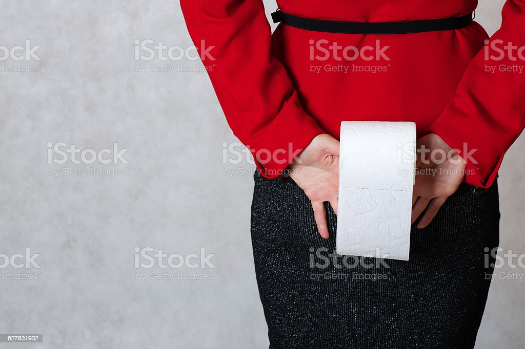 Roll of a toilet paper kept by  young woman stock photo