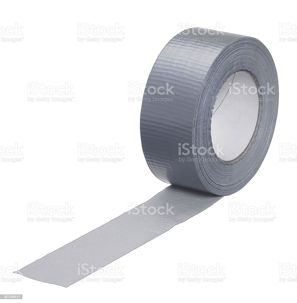 roll of adhesive grey fabric tape stock photo