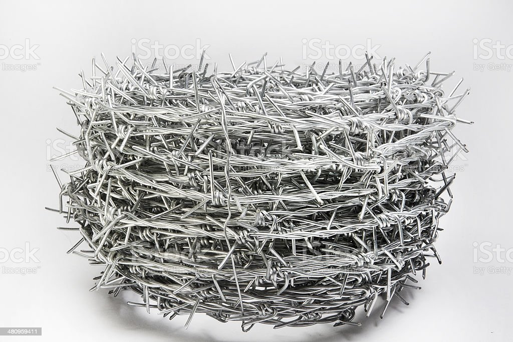roll of barbed wire stock photo