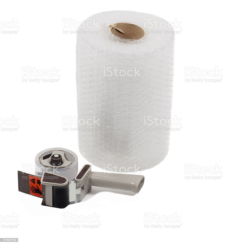 Roll of bubble wrap with tape dispenser stock photo