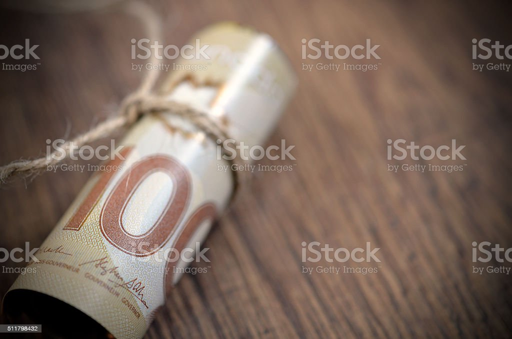 Roll of Canadian $100 Bills stock photo
