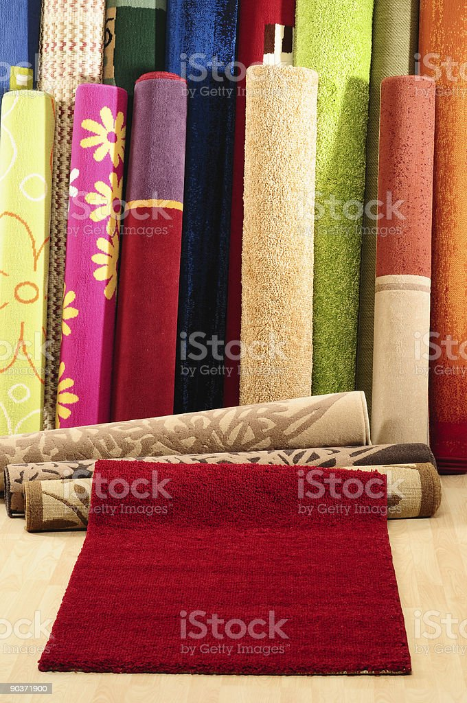 Roll of decorative carpet designs royalty-free stock photo