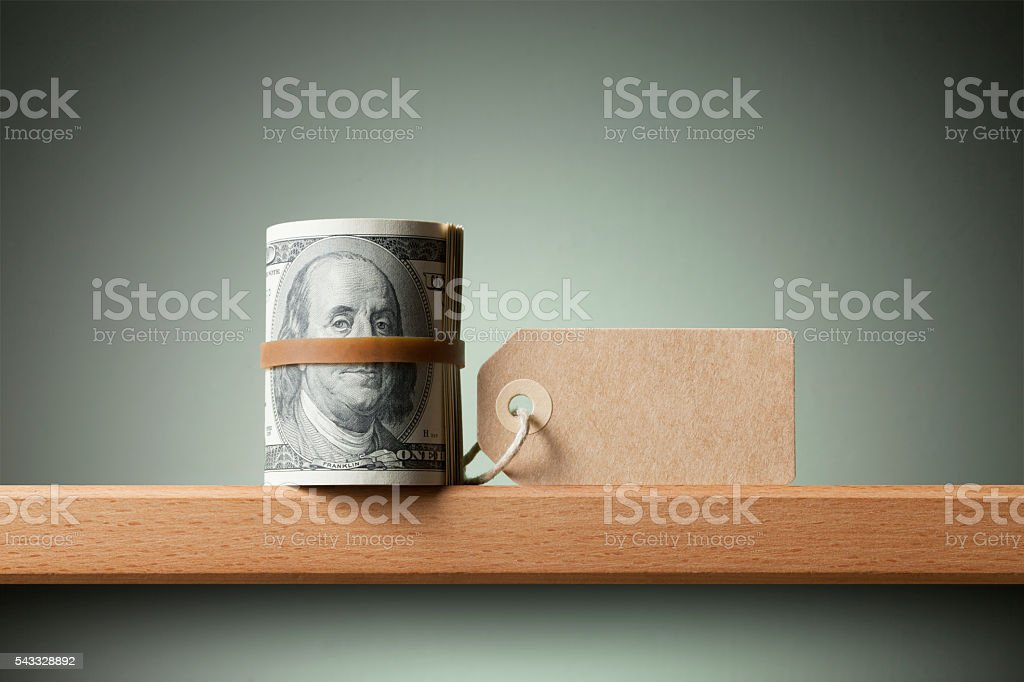 Roll of dollar banknotes with blank tag stock photo