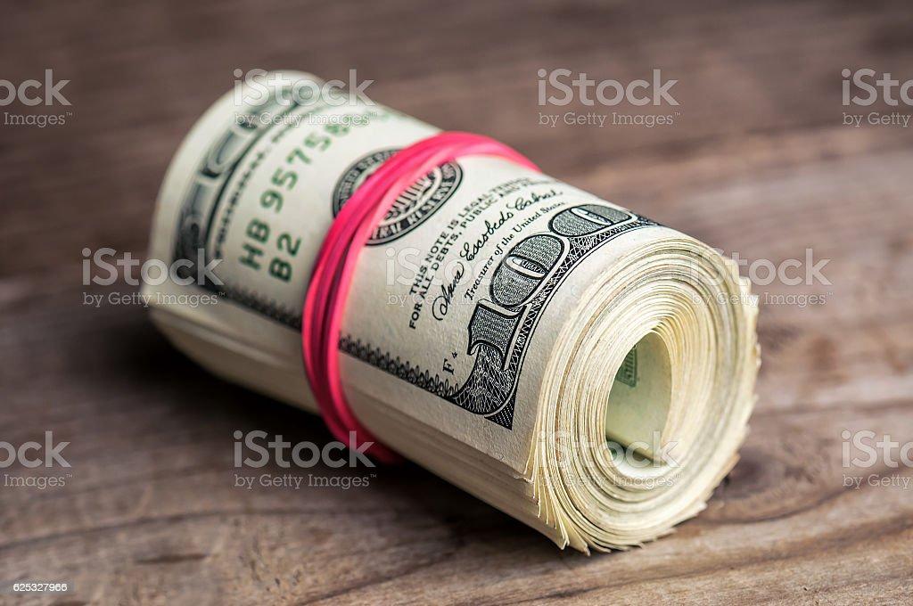 roll of dollars stock photo