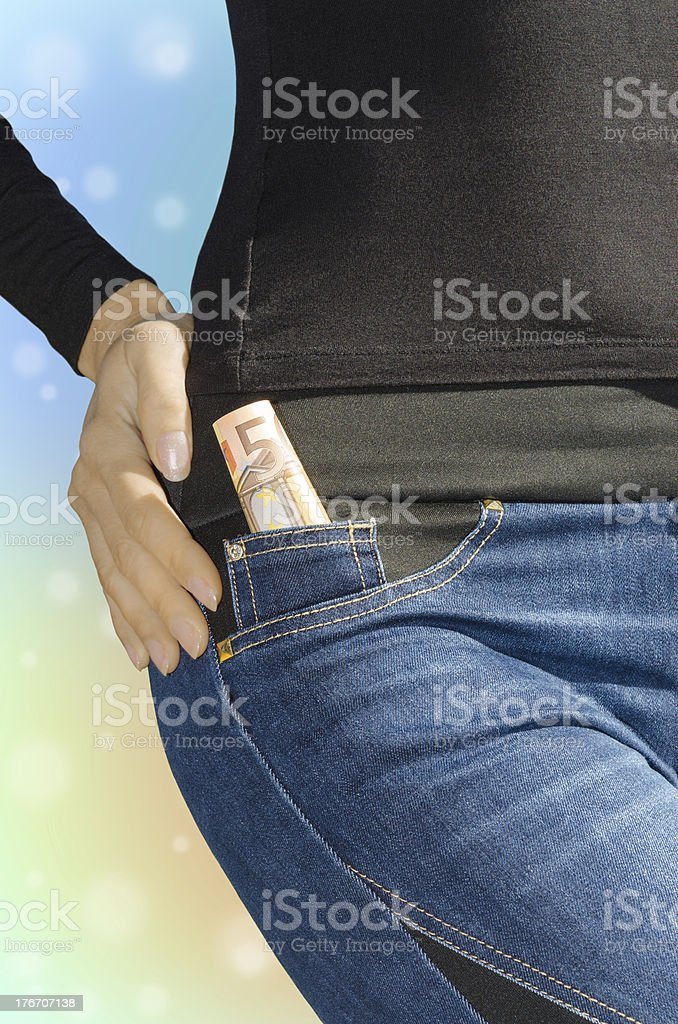 Roll of fifty euro banknotes in side pocket royalty-free stock photo