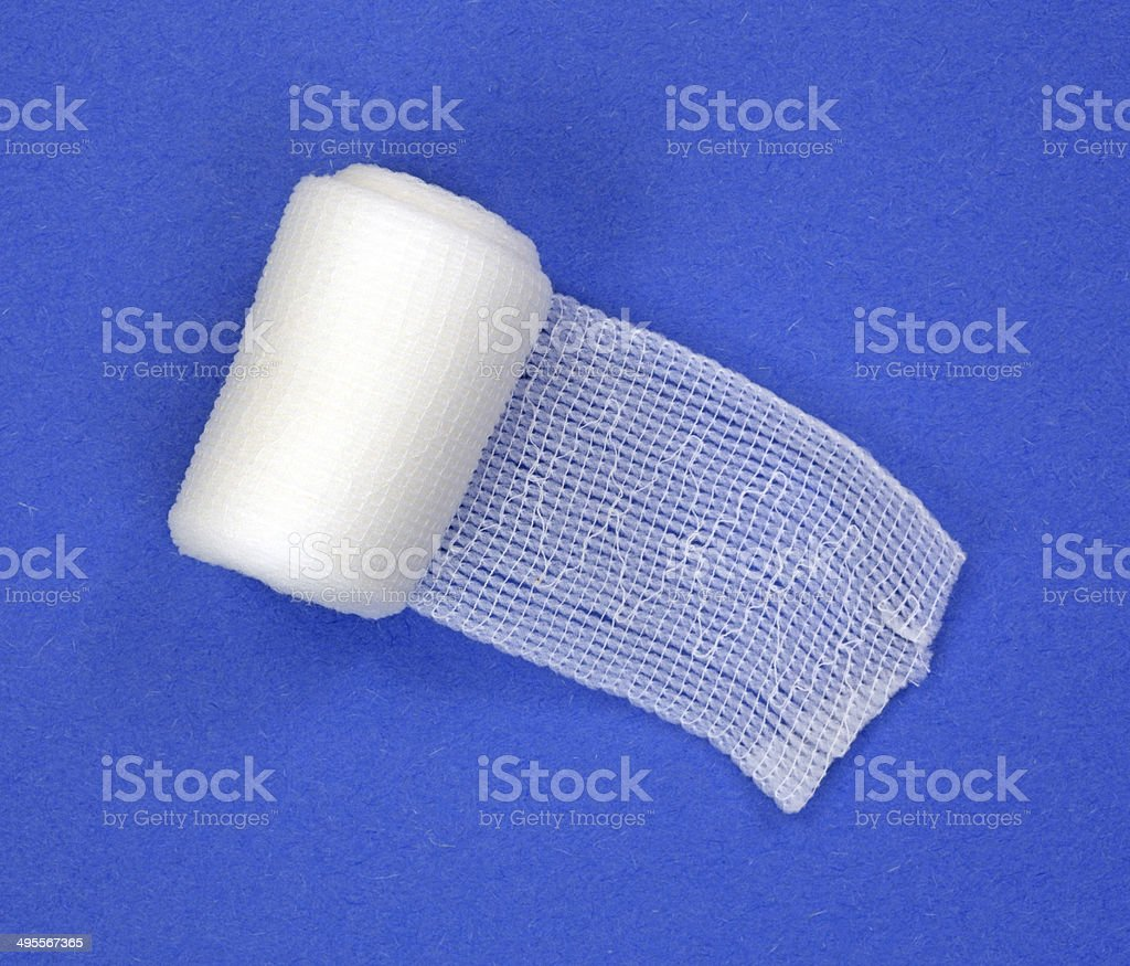Roll of first aid gauze unrolling stock photo