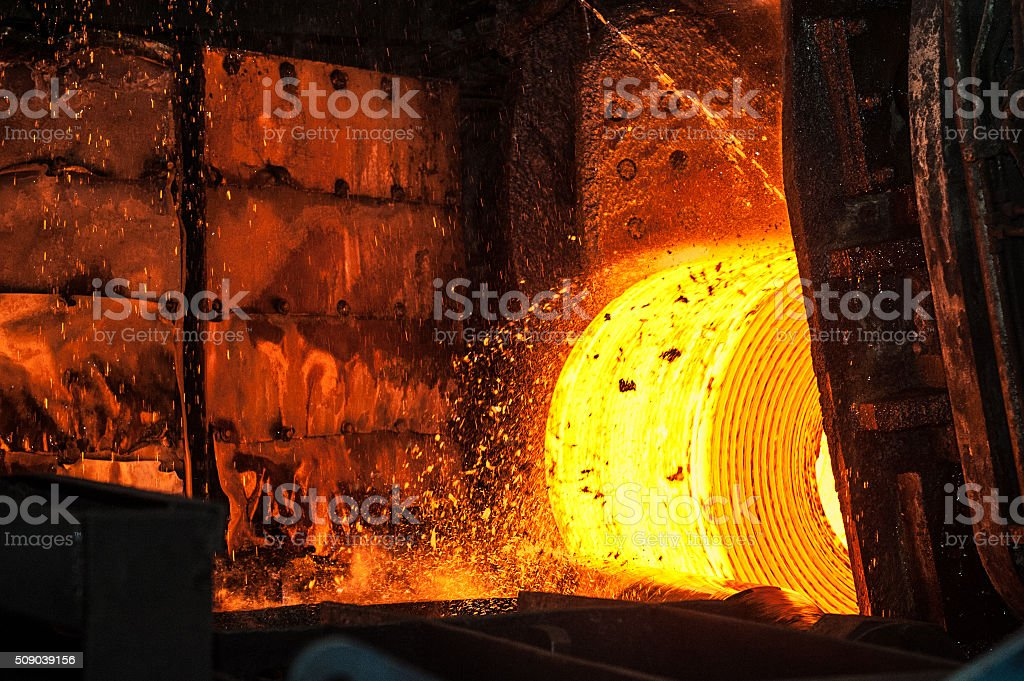 Roll of hot metal on the conveyor belt stock photo