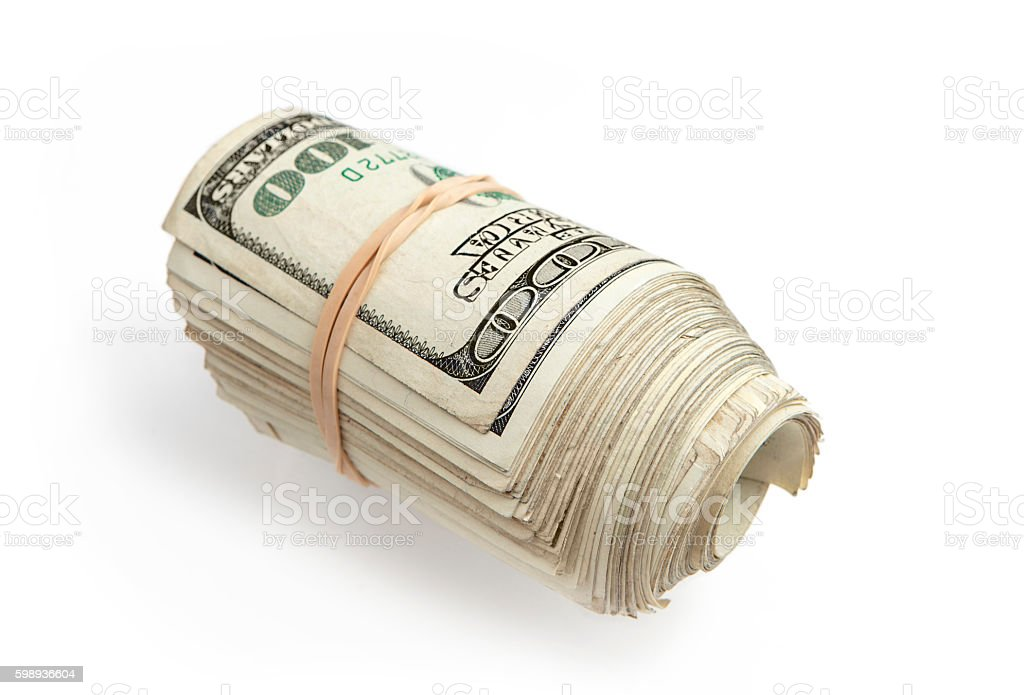 Roll of hundred dollar bills stock photo