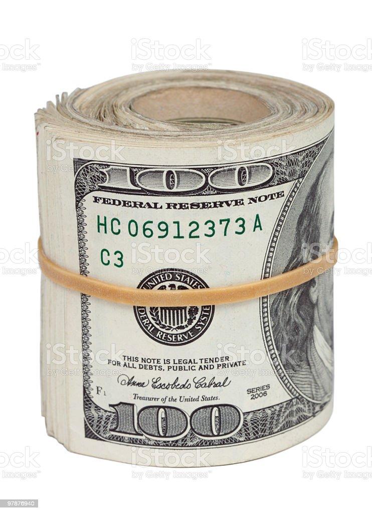 Roll of hundred-dollar bills stock photo
