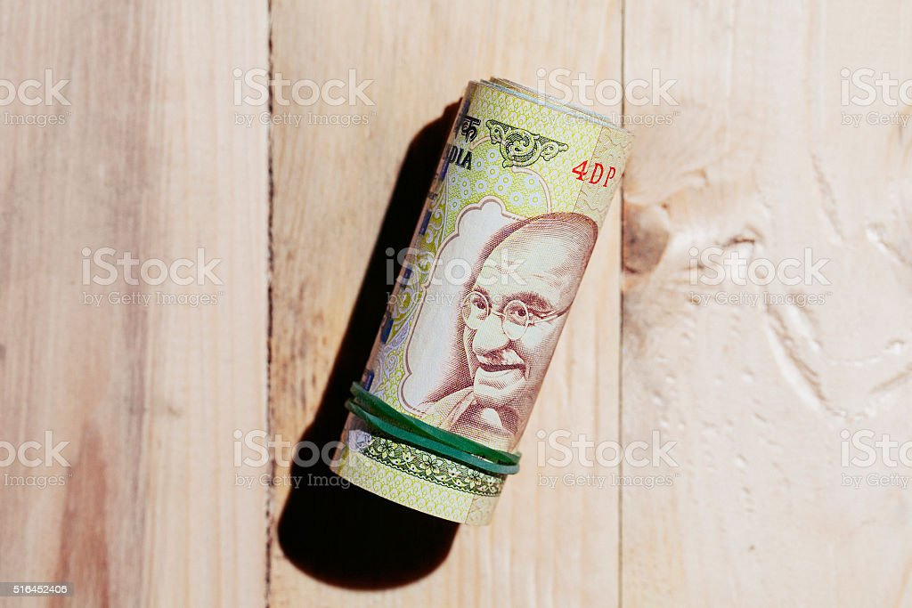 Roll of indian currency. stock photo