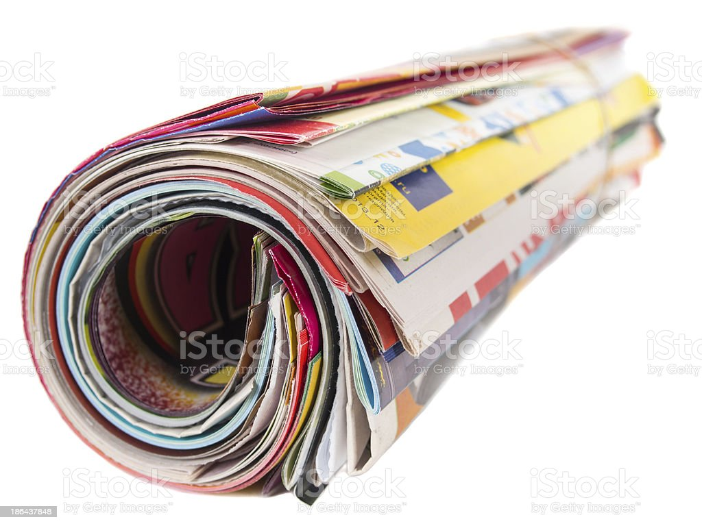 Roll of many magazines isolated royalty-free stock photo