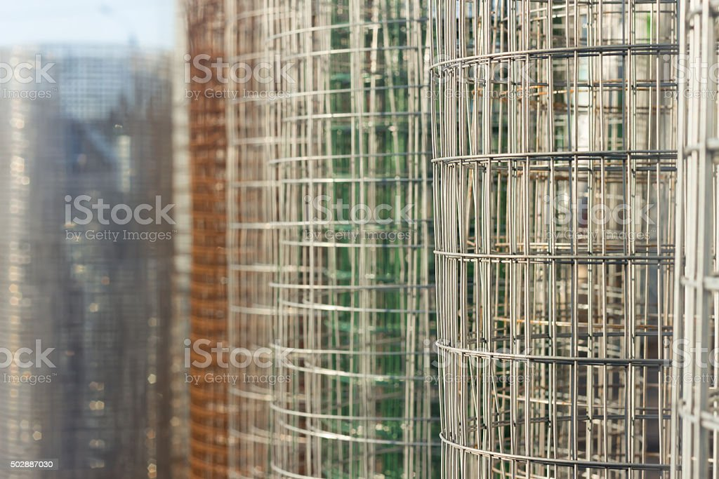 Roll of metal wire fence different colors. Selective Focus stock photo