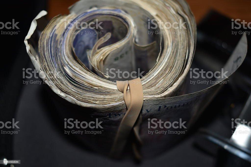 Roll of Money, twenty pound notes close up stock photo