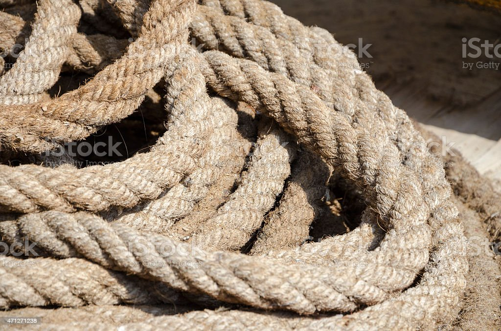 Roll of old rope stock photo