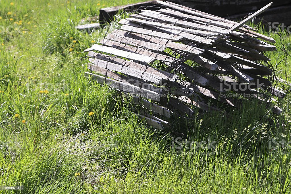 Roll of old snow fencing royalty-free stock photo