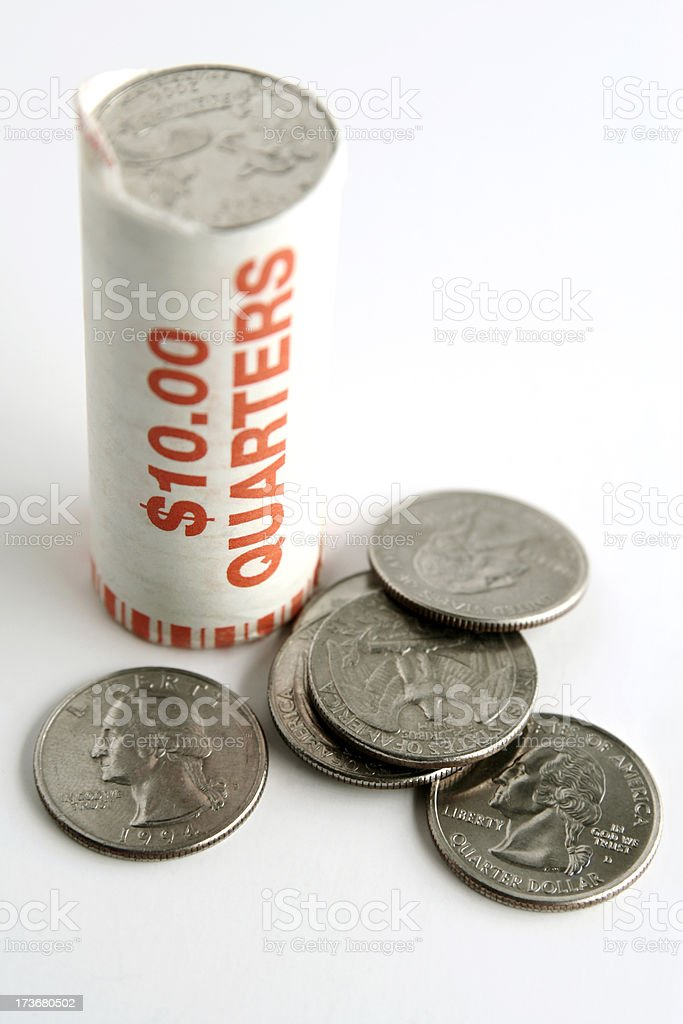 Roll of Quarters stock photo