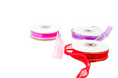 Roll of ribbon on white background