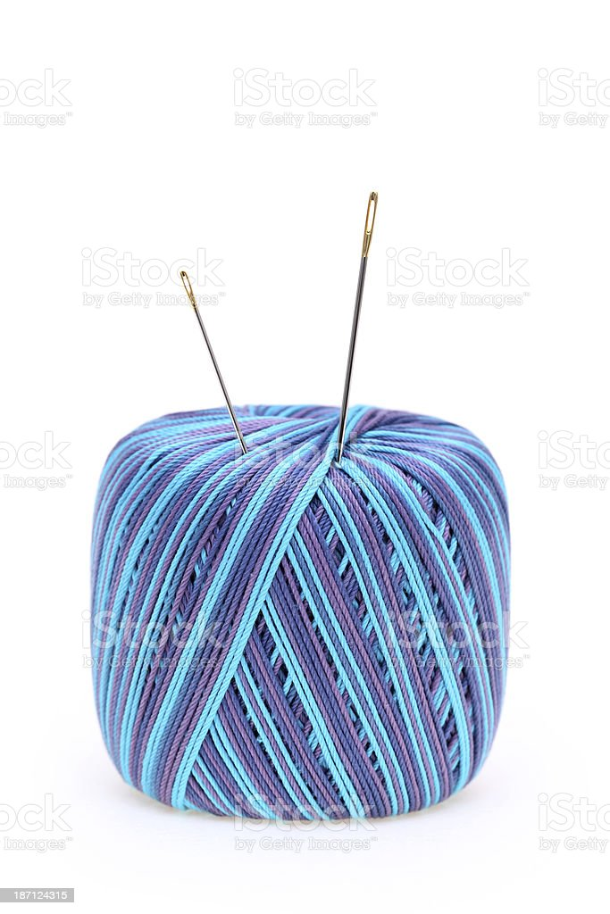 roll of sewing thread and needle royalty-free stock photo