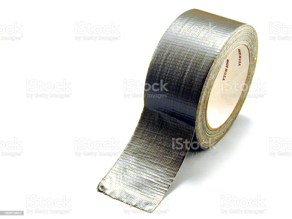 A roll of silver duct tape on a white background royalty-free stock photo