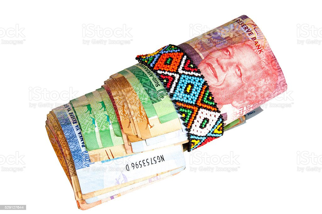Roll of South African Banknotes Secured with Zulu Beads stock photo