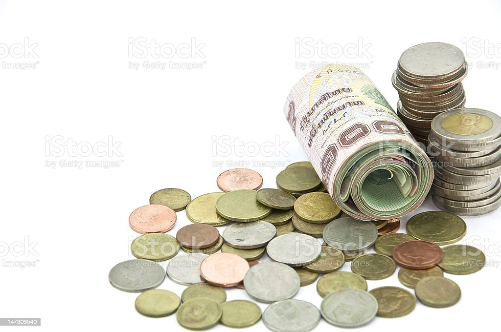 Roll of thai banknote and coin royalty-free stock photo