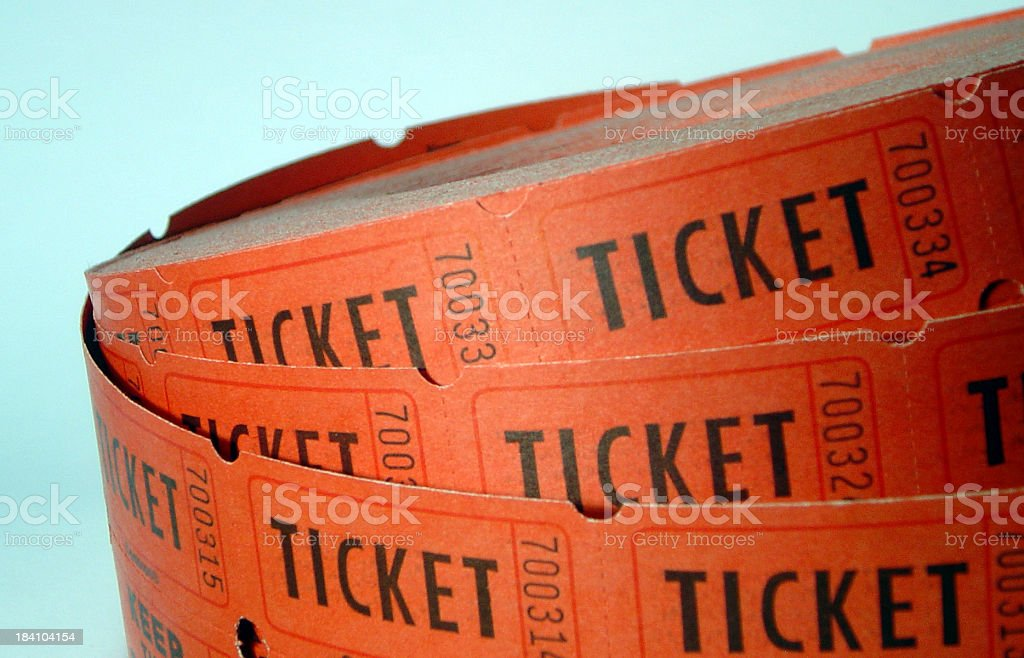 Roll of Tickets closeup on a blue background stock photo
