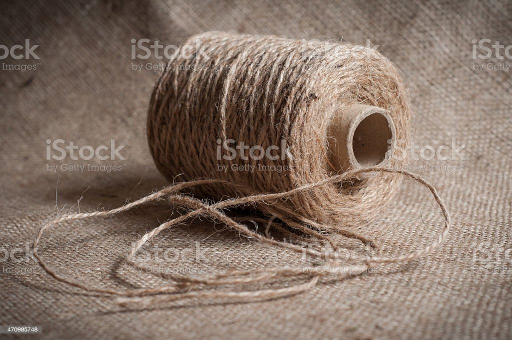 roll of twine cord on a sackcloth stock photo