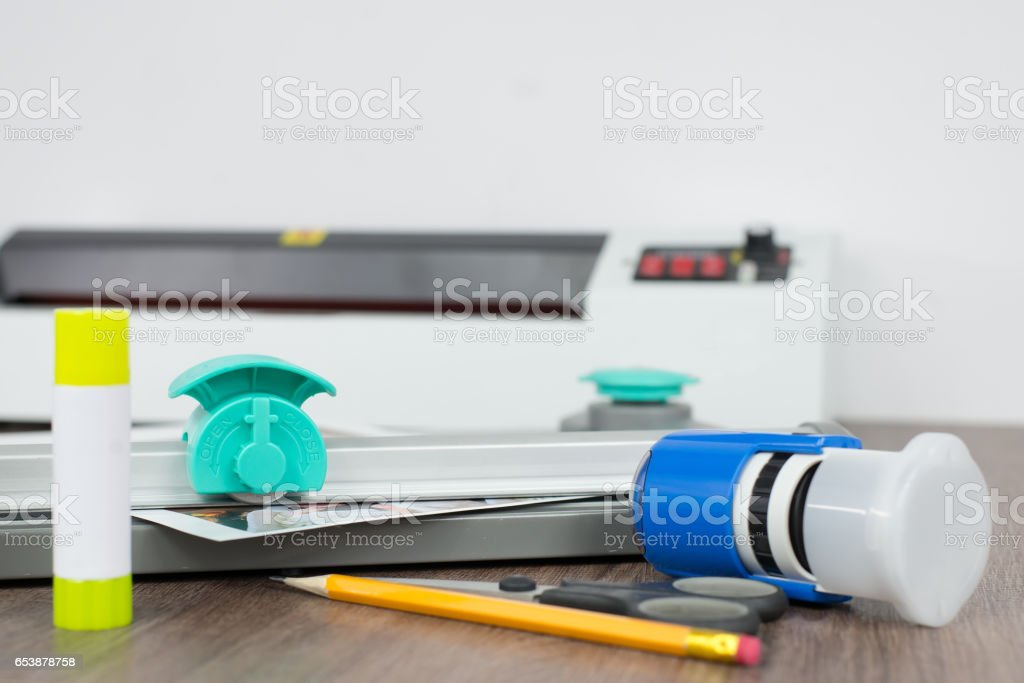 Roll paper knife on a workbench in a photo studio. stock photo
