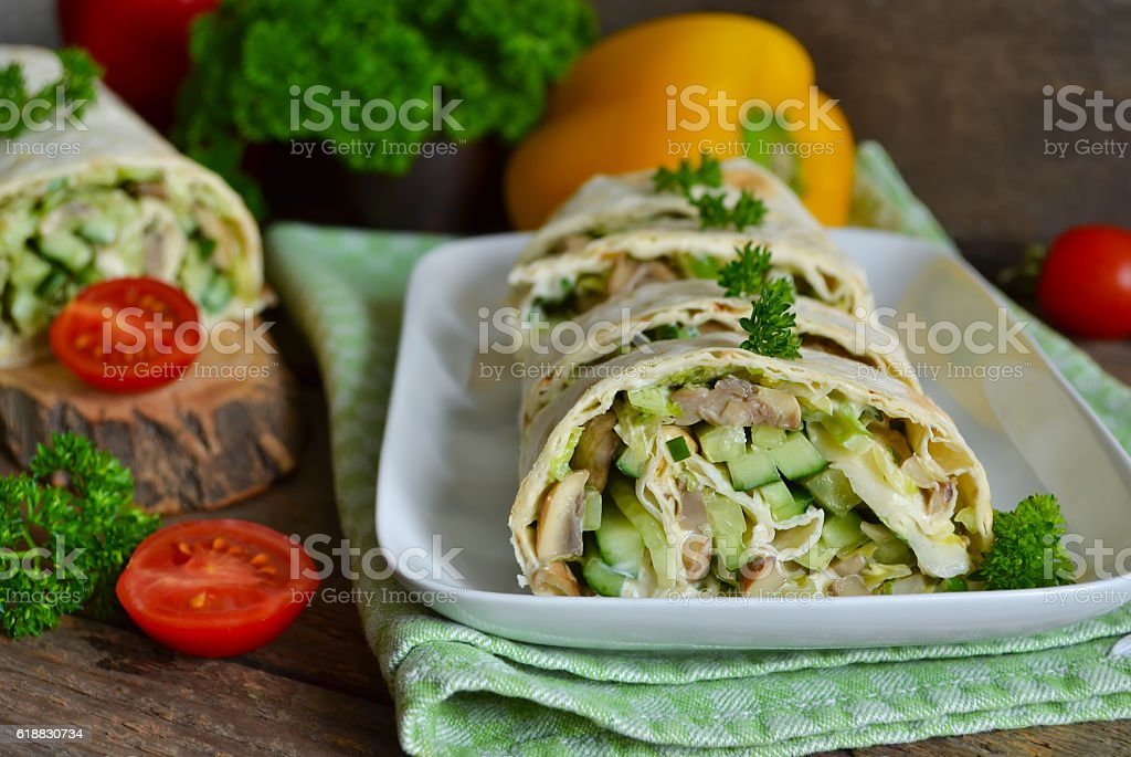 roll pita with chicken, mushrooms and vegetables stock photo