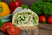 roll pita with chicken, mushrooms and vegetables