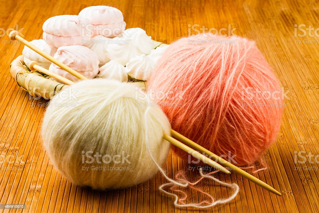 roll soft knitting yarn and wattled plate with stock photo