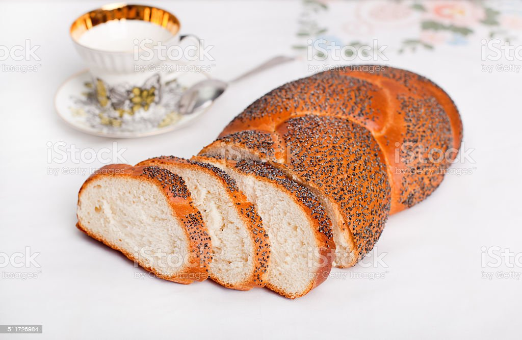 Roll with poppy seeds stock photo