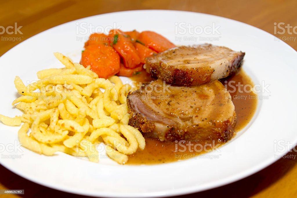Rollbraten mit Spaetzle und Karotten stock photo