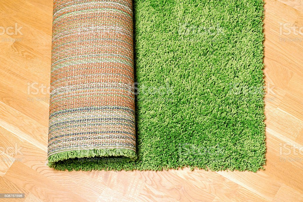 rolled carpet on the floor stock photo