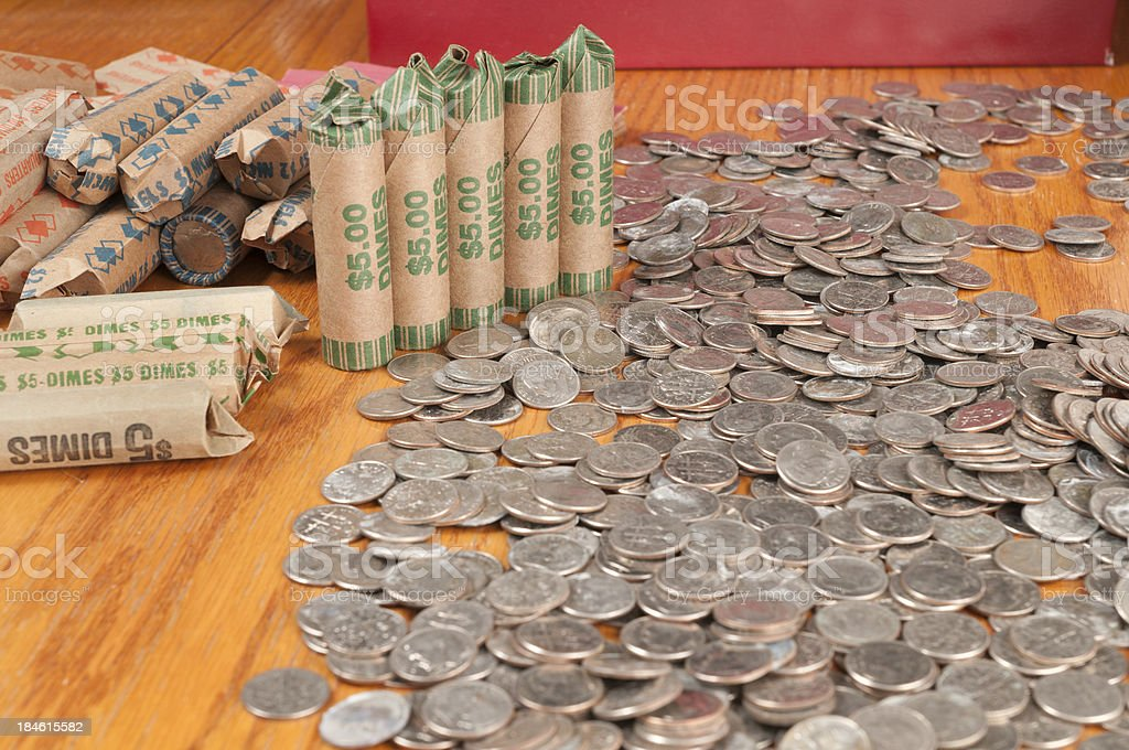 Rolled Coins and Dimes in a Pile stock photo