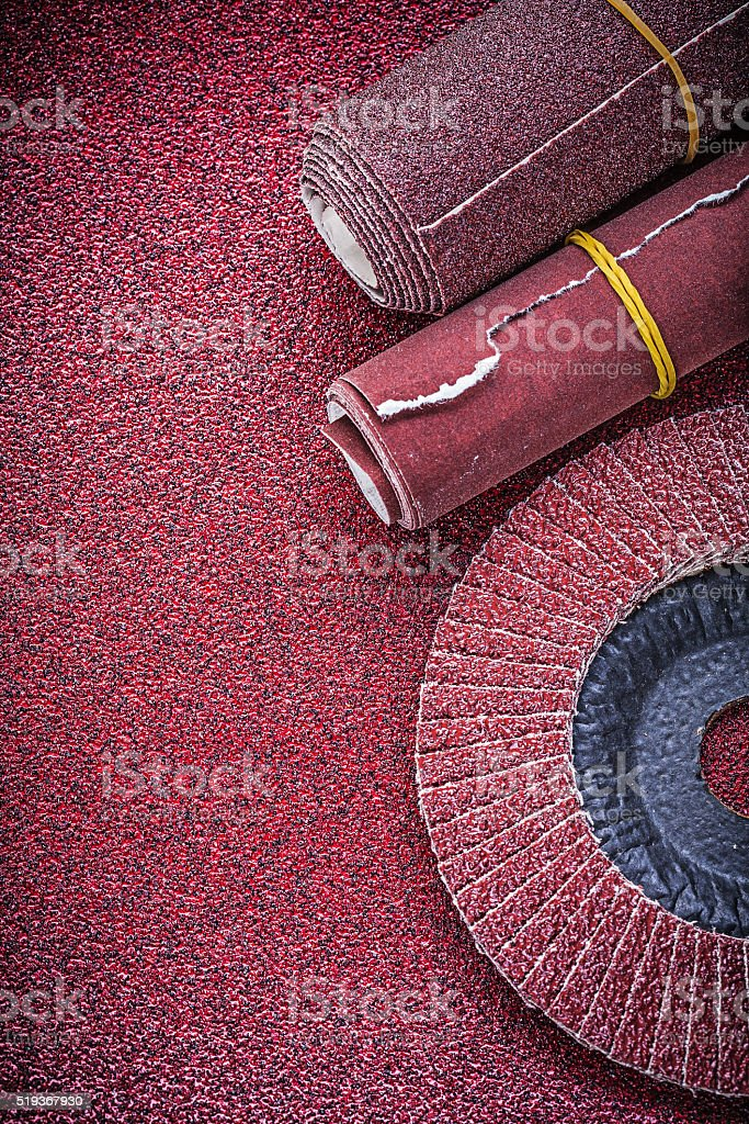 Rolled emery paper flap grinding wheel on abrasive sheet stock photo