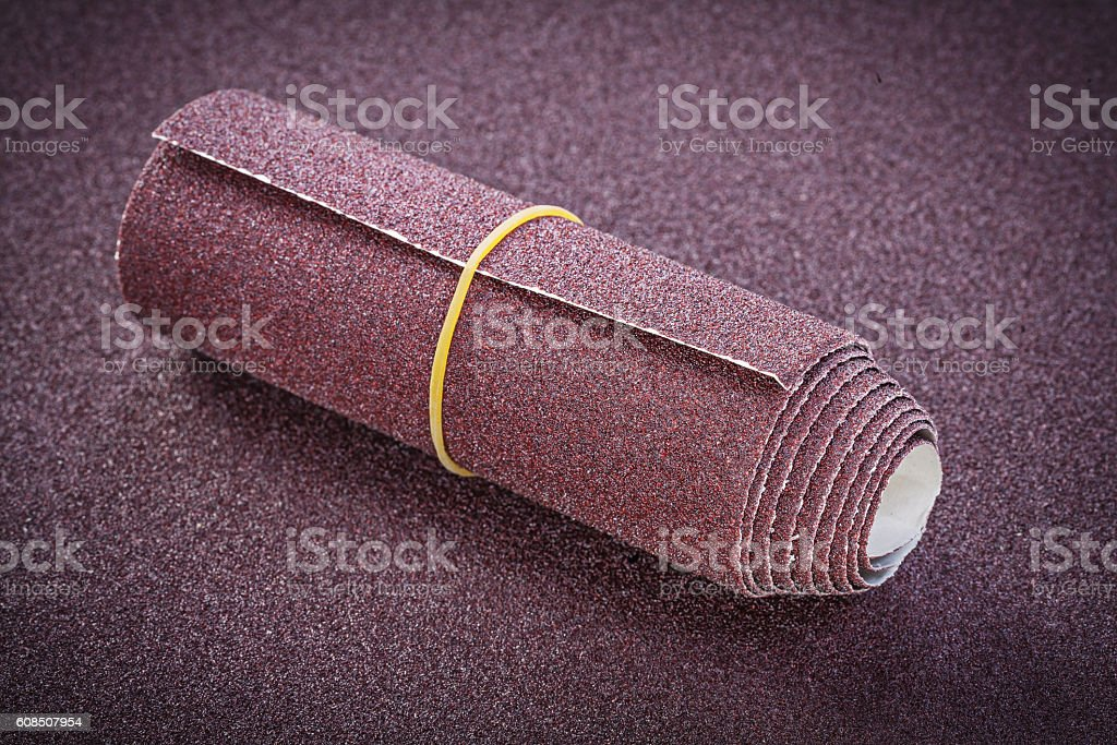 Rolled emery paper on polishing sheet abrasive materials stock photo