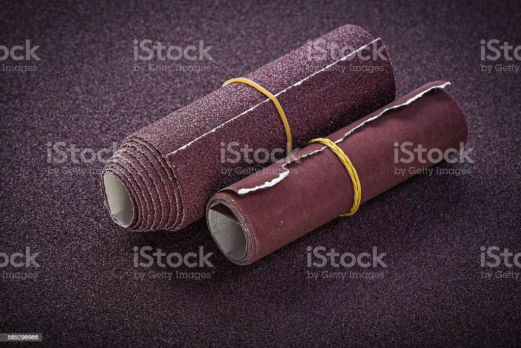 Rolled emery paper top view abrasive tools stock photo