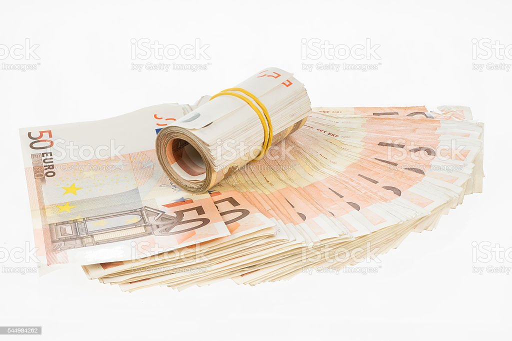 Rolled euros on fifty euro banknotes fan. Money bunch stack stock photo