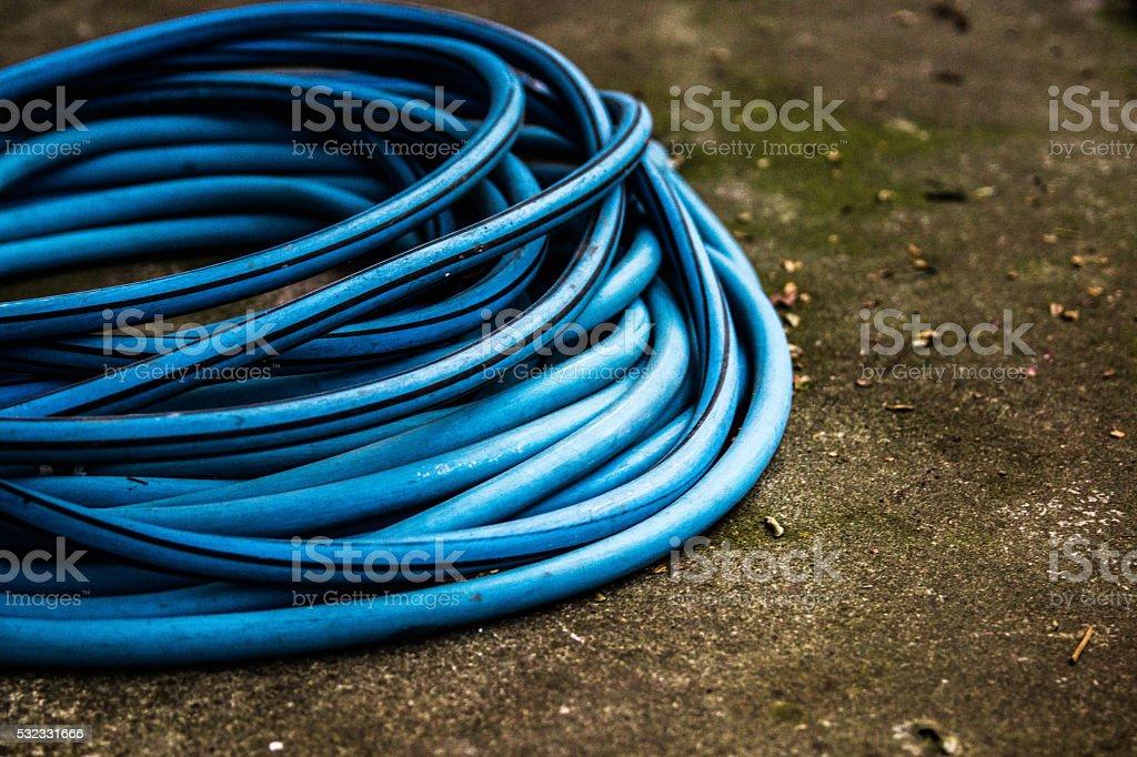 Rolled garden hose stock photo