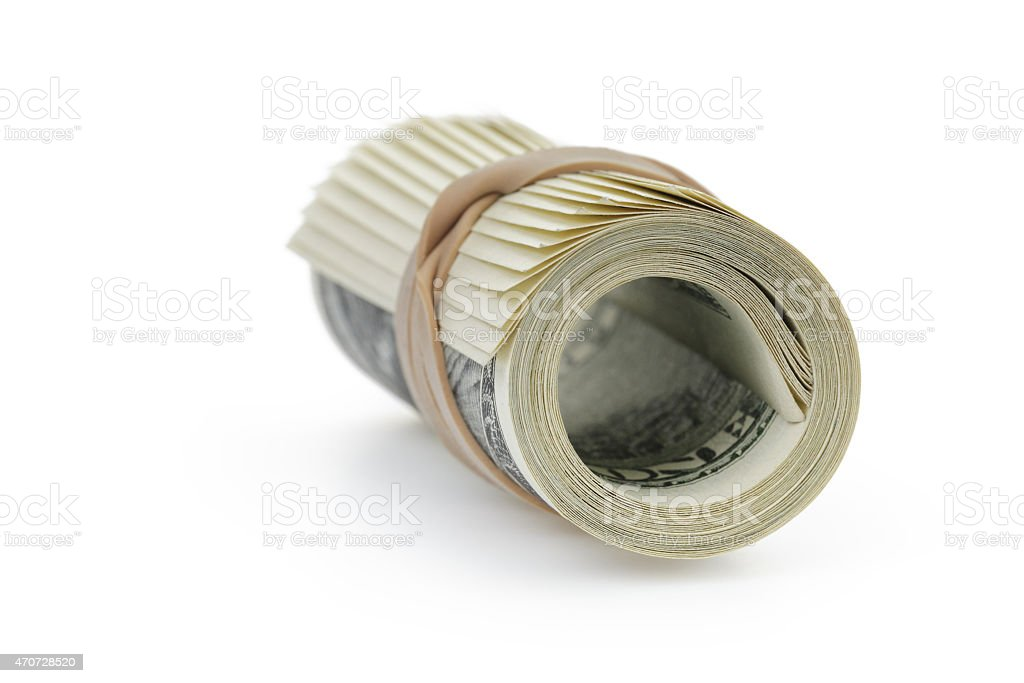 rolled hundred dollar banknotes tied with rubberband stock photo