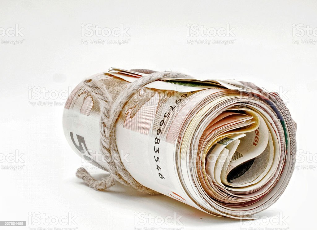 rolled large amount of bills stock photo