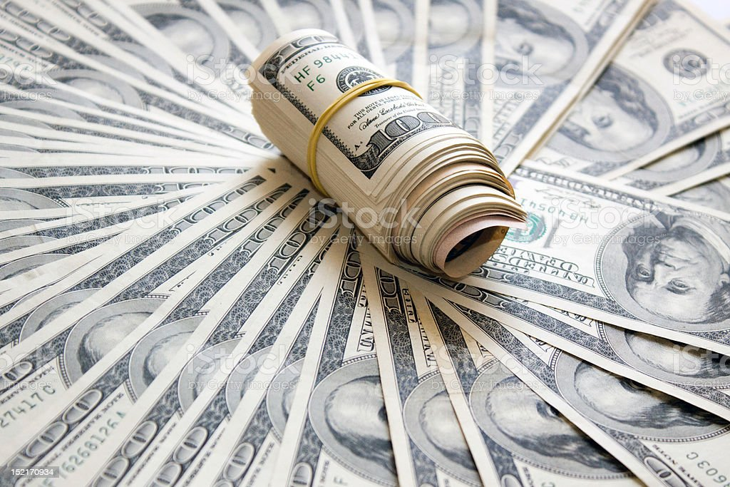 Rolled money cutout on a background dollars royalty-free stock photo