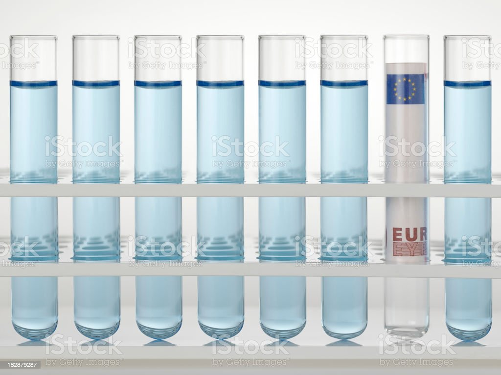 rolled money in test tube royalty-free stock photo