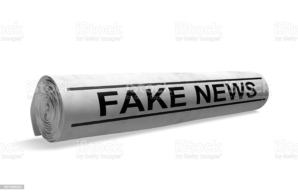 Rolled newspaper with fake news headline for bad media journalism stock photo